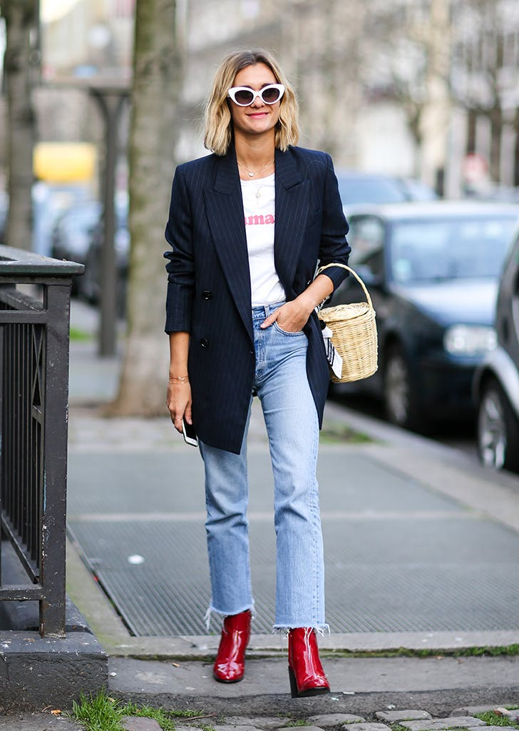 woman wearing jeans blazer and red boots