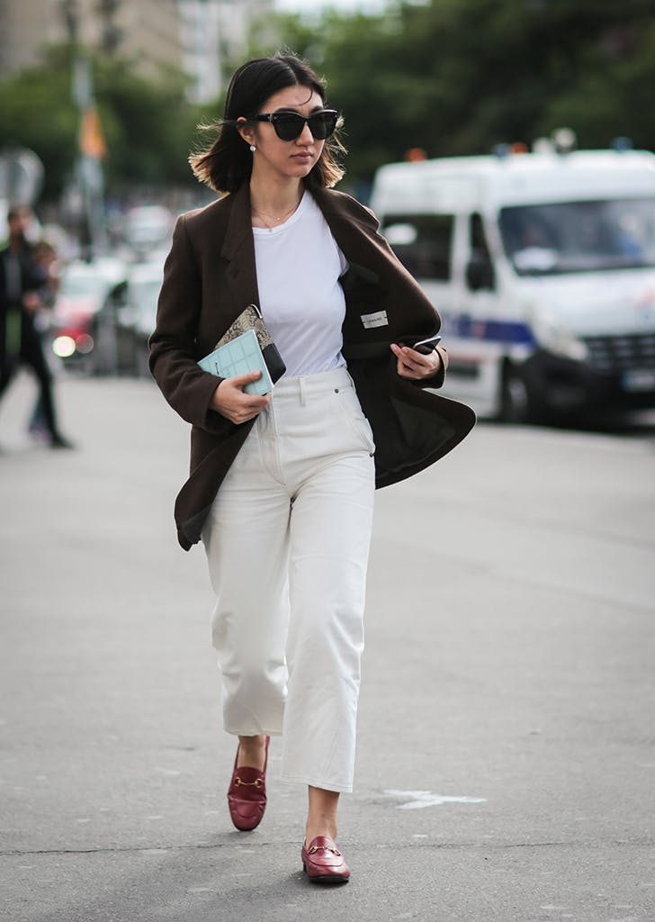 woman wearing white jeans and loafers