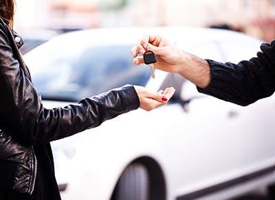 woman buying new car cat