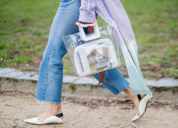 woman carrying a clear handbag
