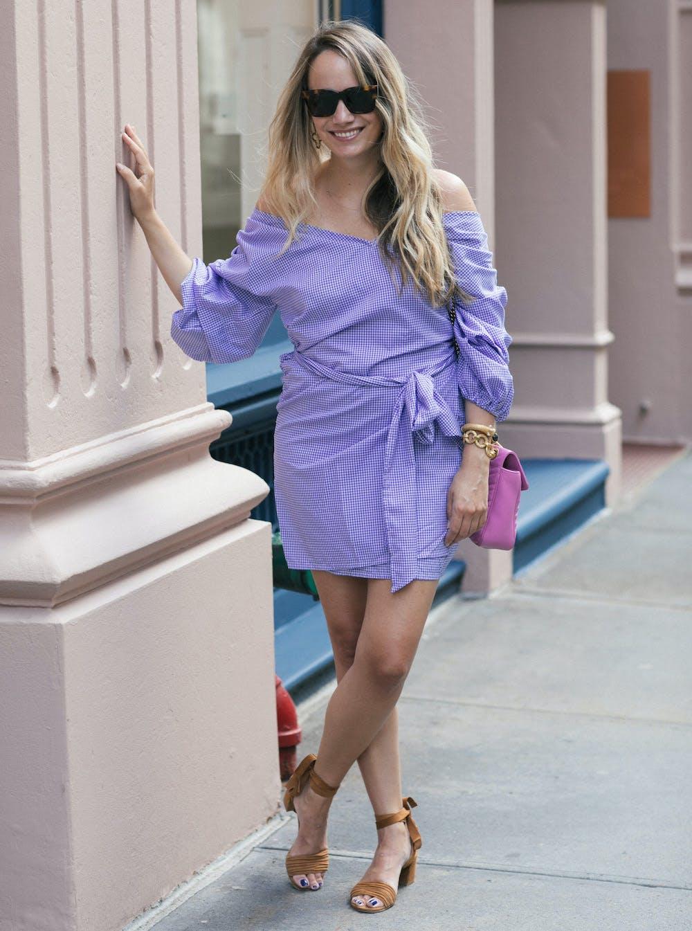 woman wearing a purple gingham dress