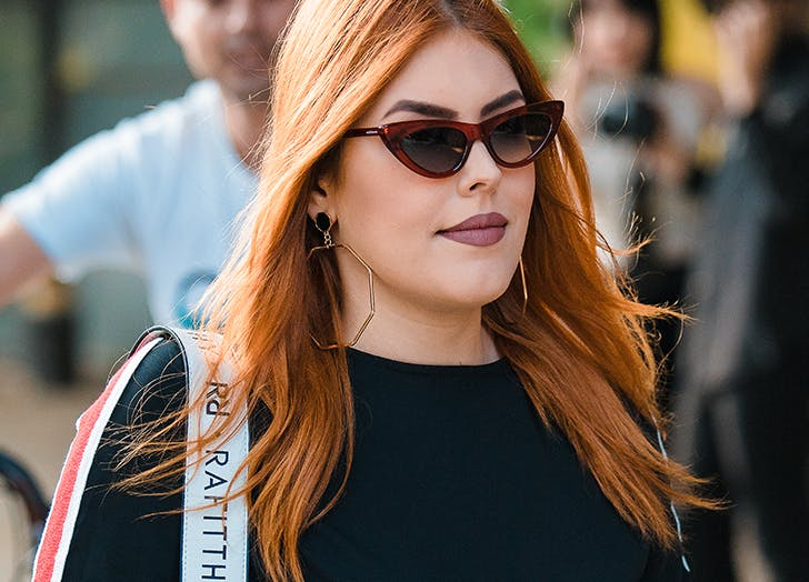 woman wearing tiny sunglasses