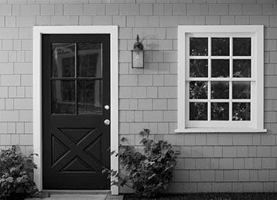 Black front door of home 400