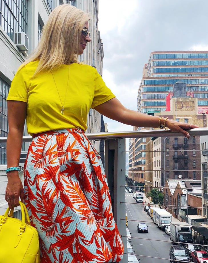 Jaclynn Brennan wearing super bright sshades of yellow red and blue