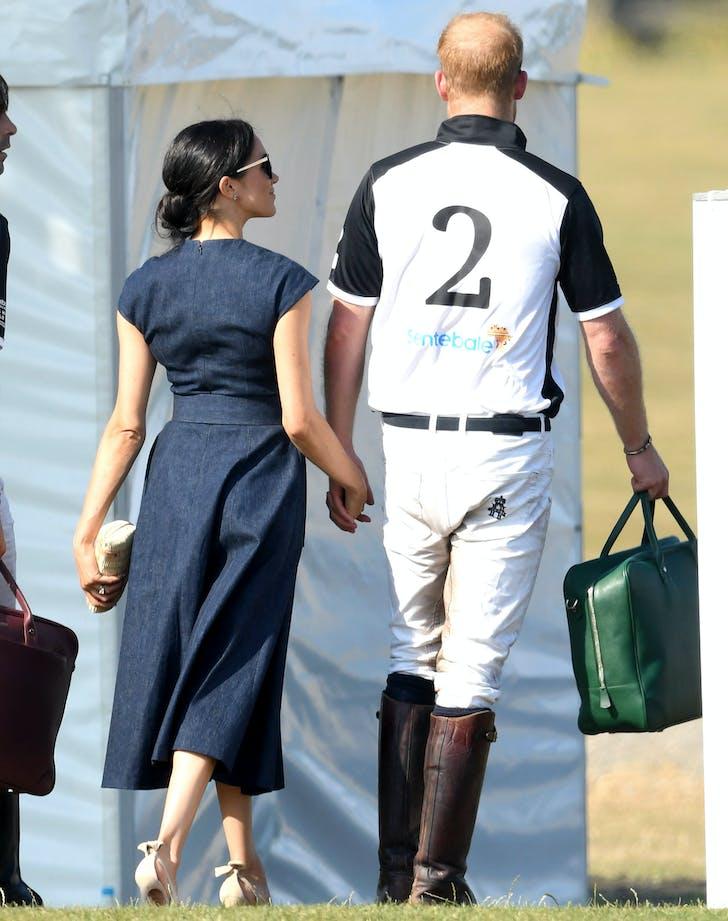 Meghan Markle Prince Harry hold hands
