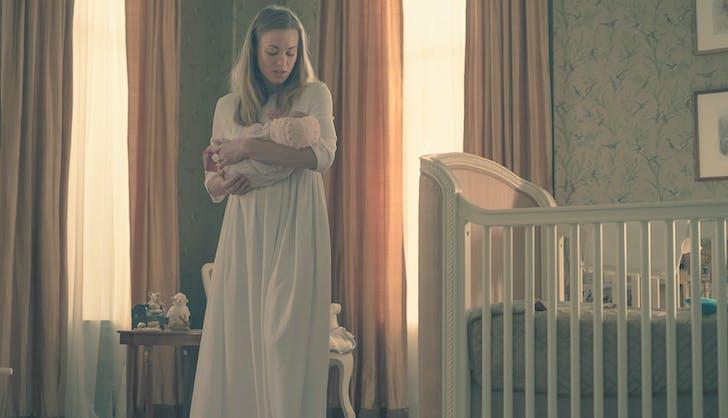 Serena cradles baby nicole handmaids tale