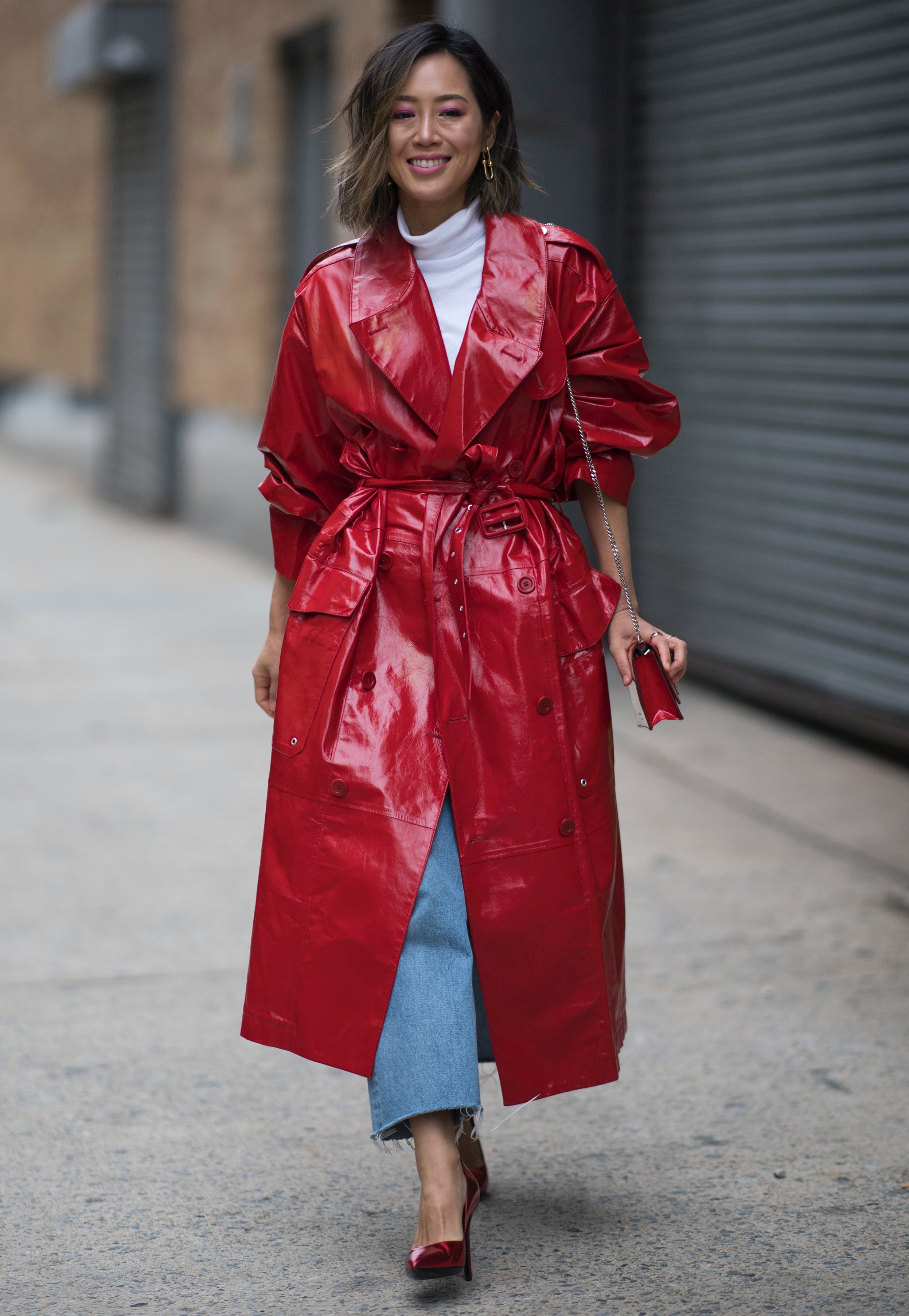 aimee song wearing a bold red trench coat