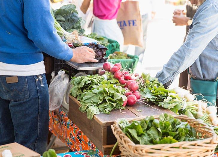 couple at farmers market date idea