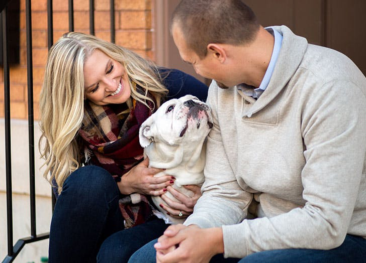 couple playing with dog date idea