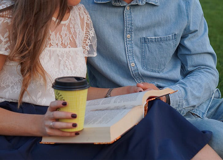 couple reading book together date idea
