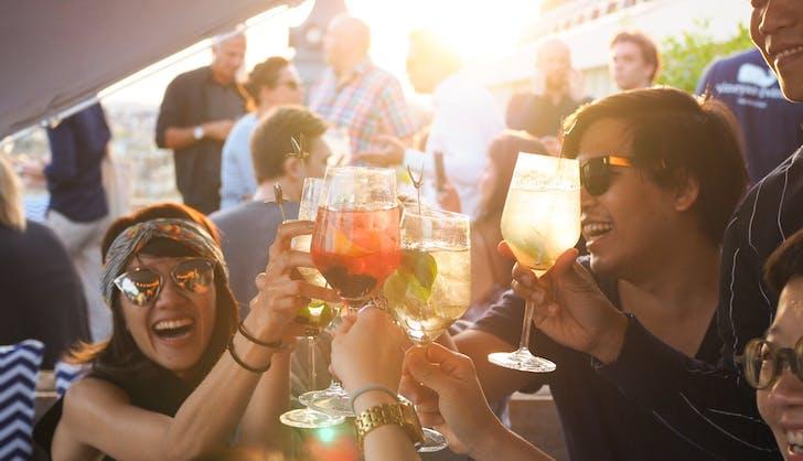 friends enjoying cocktails together