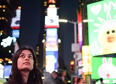 girl looking up in times square 400