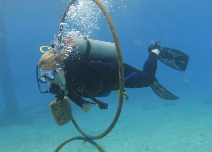 girl scuba diving ocean