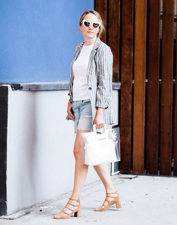 grace atwood wearing a stripe blazer and denim shorts
