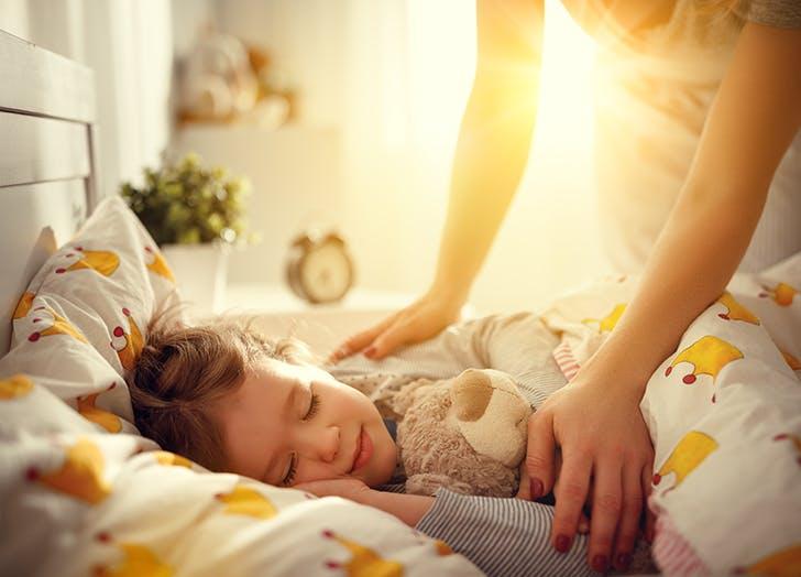 mom waking up child