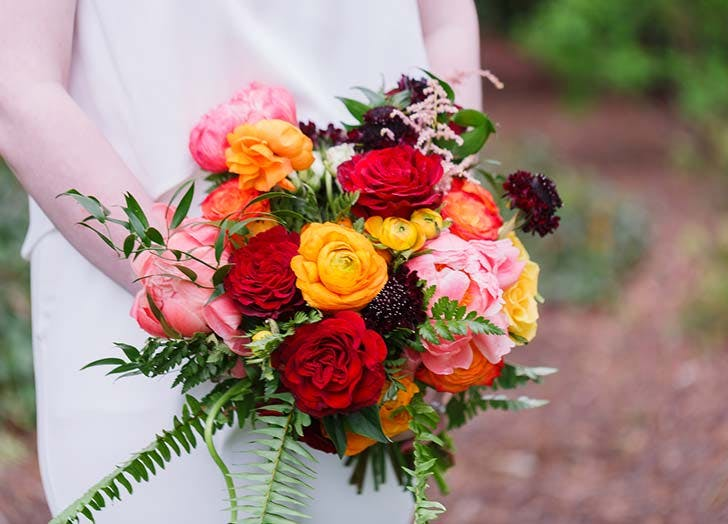 orange ranunculus wedding bouquet