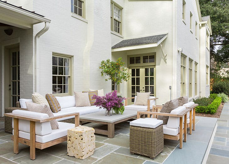 small patio with lots of furniture