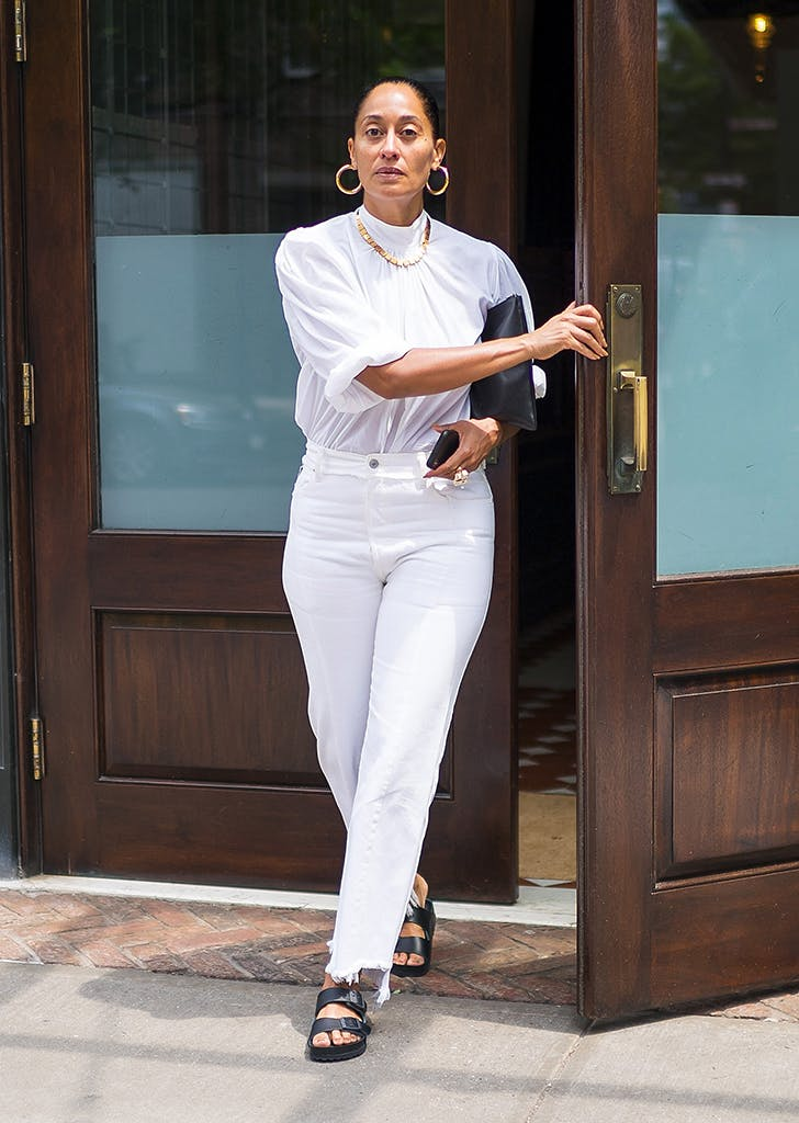 tracee ellis ross wearing white top and white jeans 1