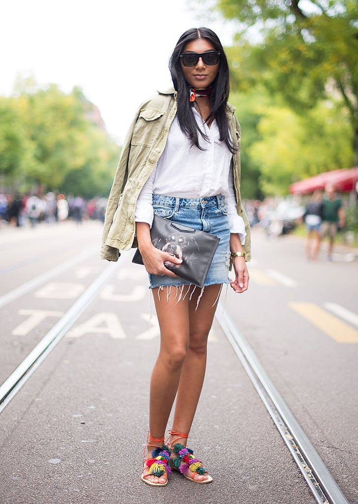 woman wearing a button down and jean skirt