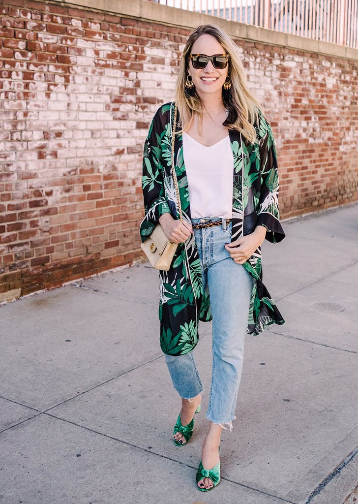 woman wearing camisole jeans kimono
