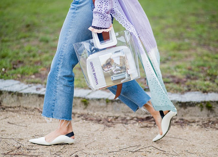 woman carrying a trendy clear handbag