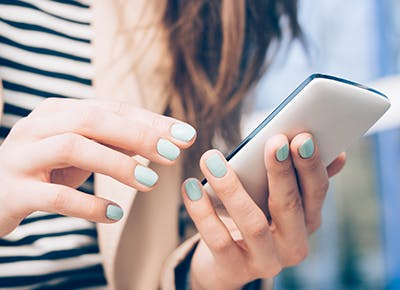 woman holding phone 400
