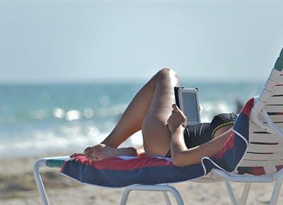 woman reading on beach 400