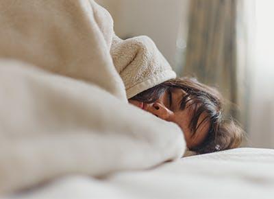 woman sleeping in bed 400