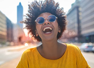woman smiling with sunglasses on 400