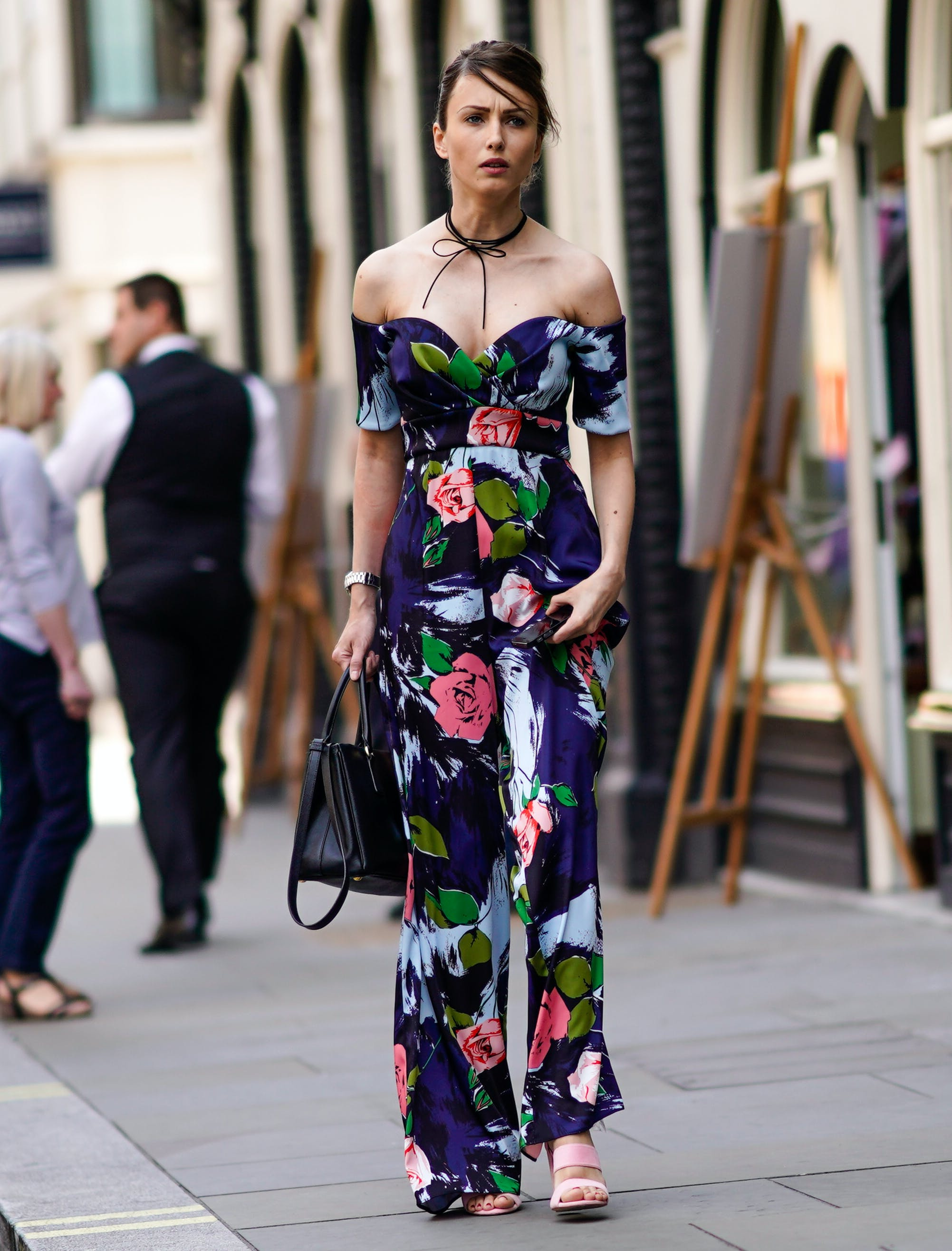 woman wearing a floral off the shoulder jumpsuit