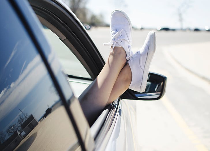 womans feet out of car