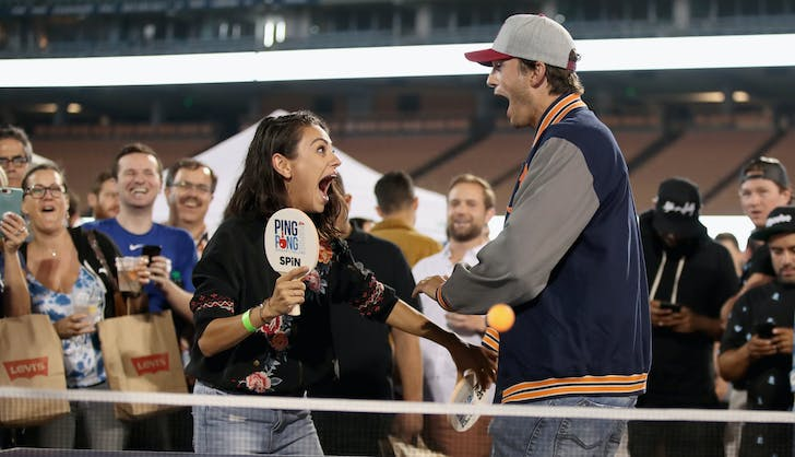 Ashton Kutcher Mila Kunis looking excited at ping pong tournament