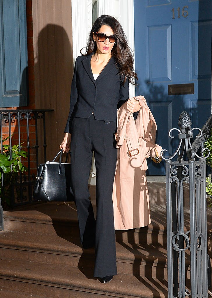 amal clooney wearing a black blazer and flared pants