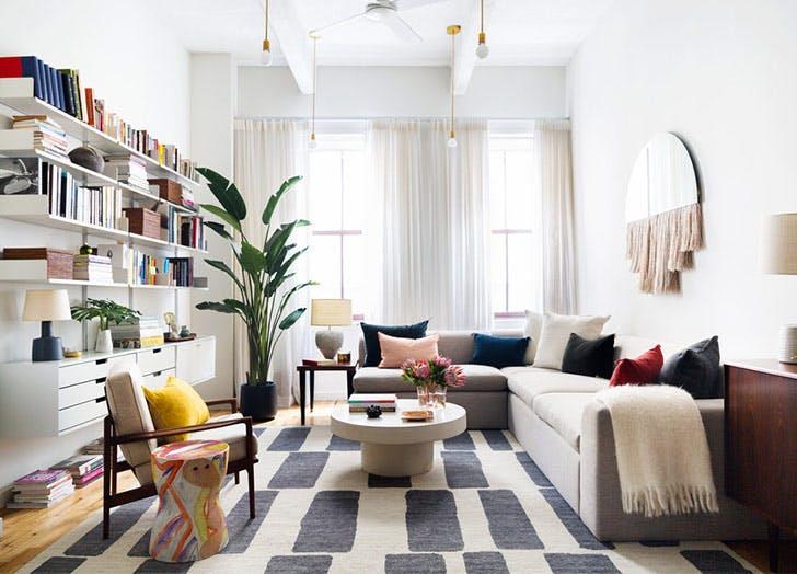 bella mancini colorful living room bookcase