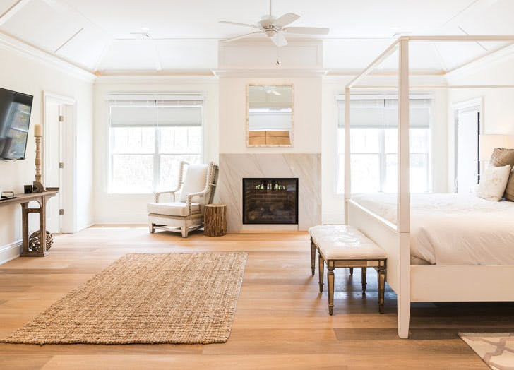 east hampton beach house white bed fireplace tv