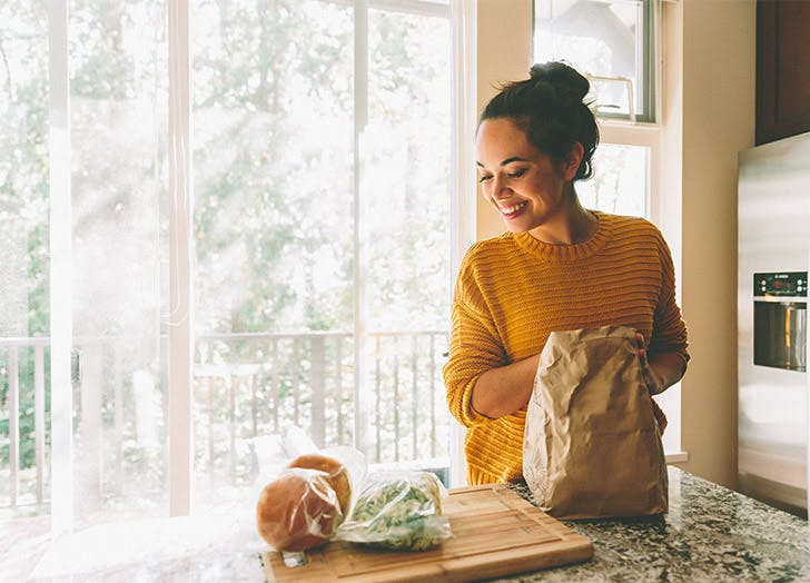 girl in kitchen with groceries