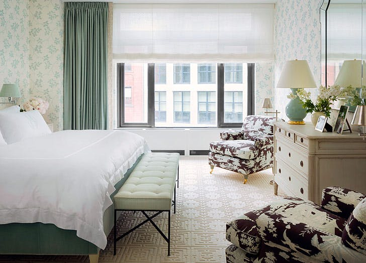 green bed green shades two chairs bedroom