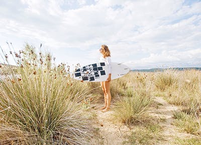 gril with surfboard on beach 400