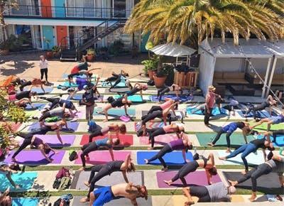 group of people doing yoga outside 400