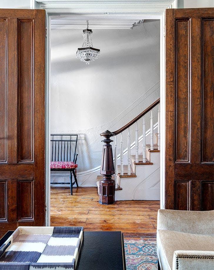 hallway stairs wood chairs