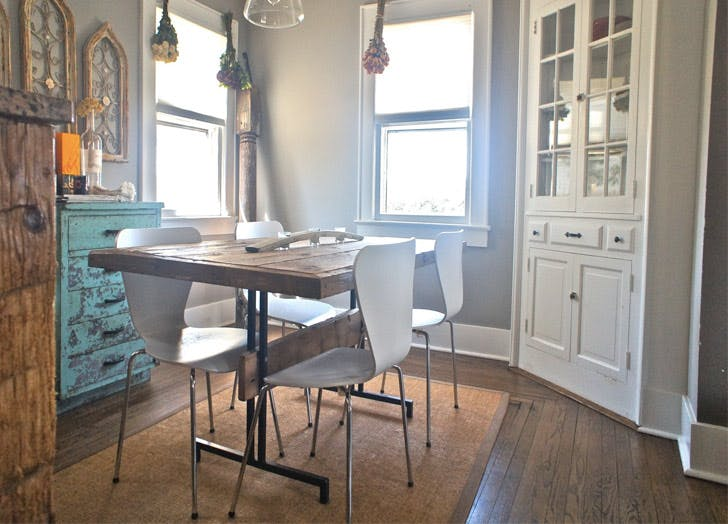 hamptons farmhouse kitchen wood table windows