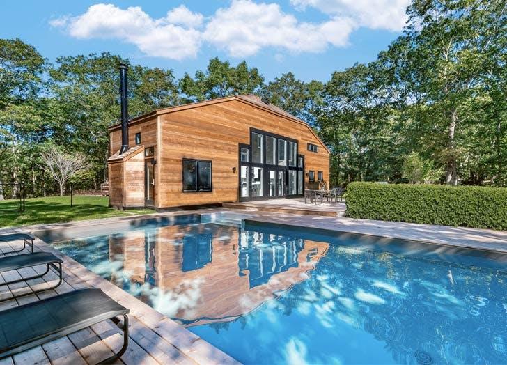 hamptons modern home pool sky