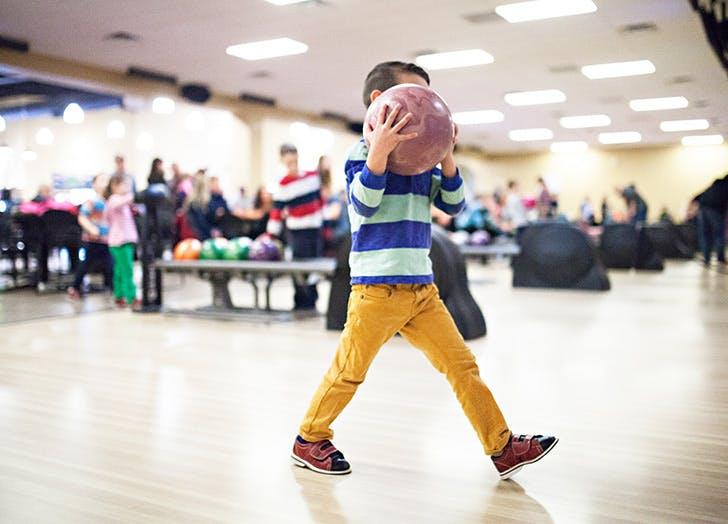 little boy bowling