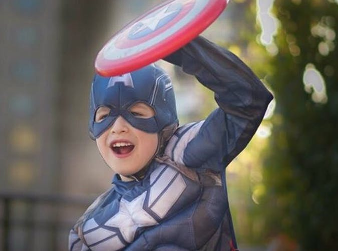 little boy dressed as captain america sheild
