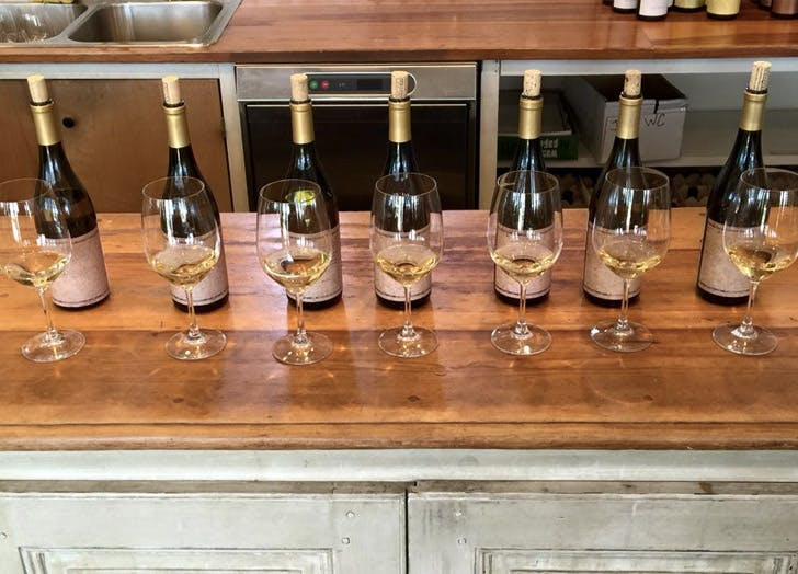 long island wine glasses bottles countertop wood
