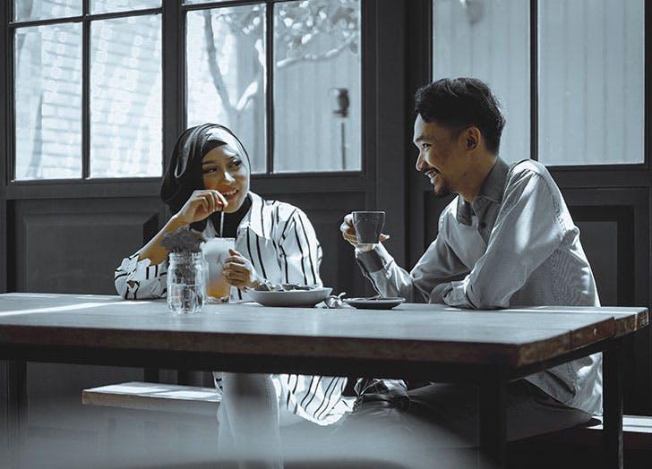 man and woman enjoying a coffee date