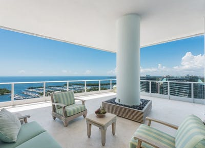 miami extreme houses blue and white chairs patio sky 400