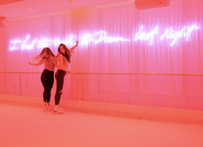 two girls dancing neon sign pink miami 400
