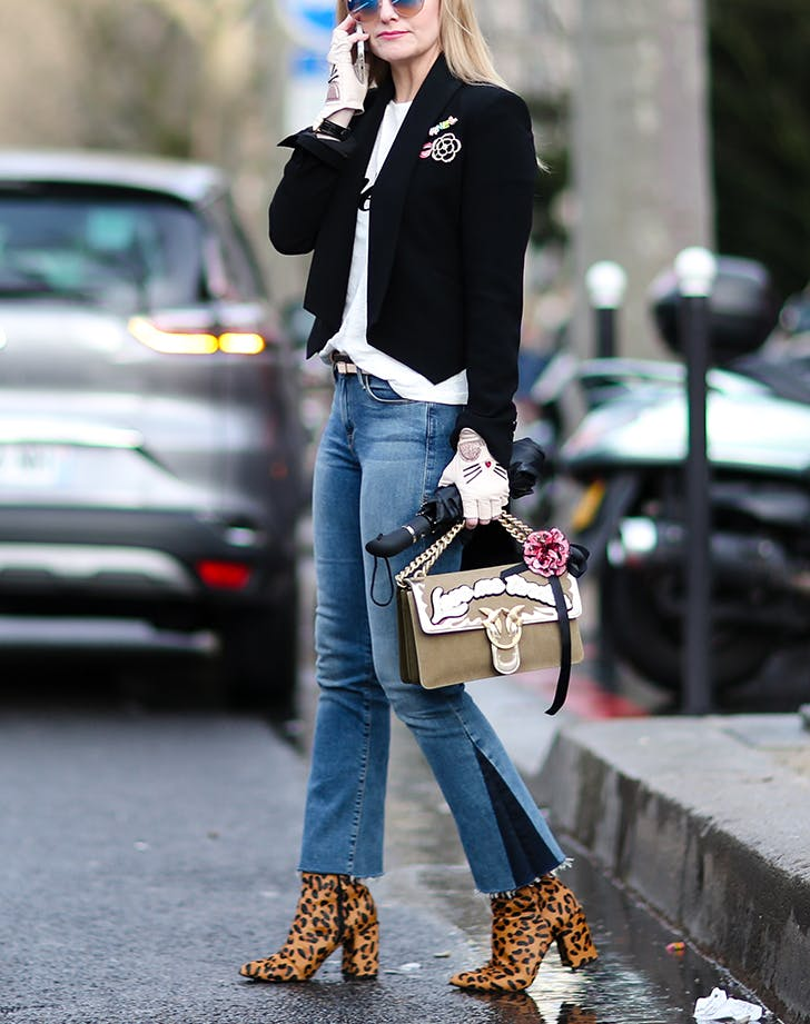 woman wearing jeans and leopard boots