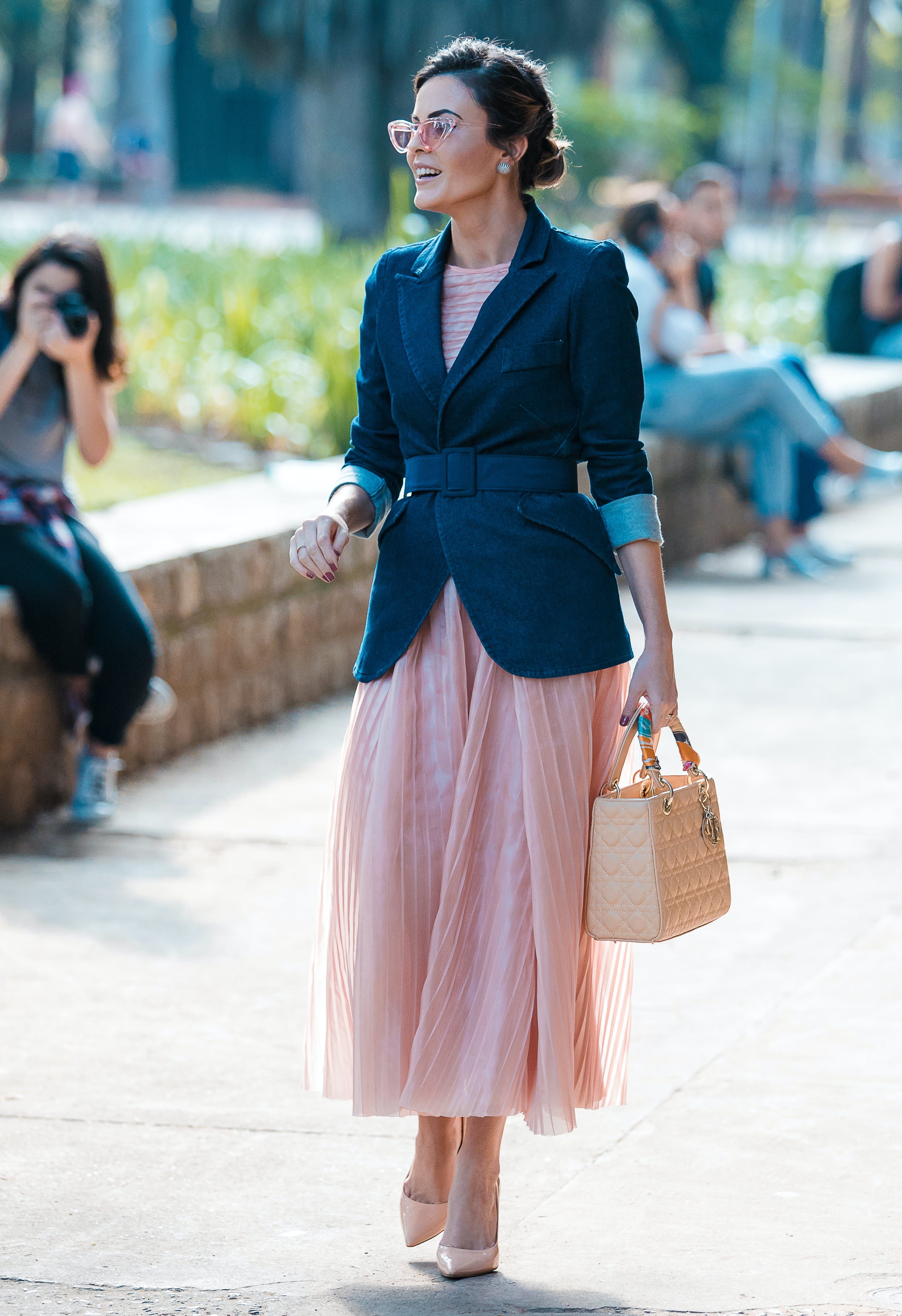 woman wearing a blazer belted over a dress